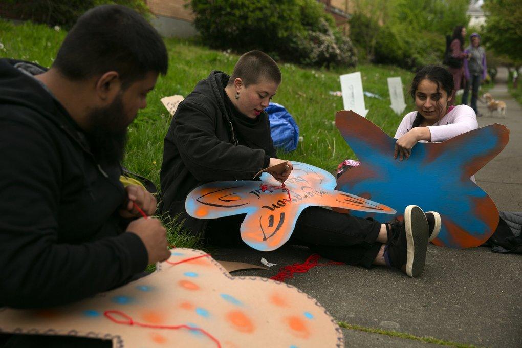 "Crowds gather for a ""pop-up"" block party on May Day protesting youth incarceration and the proposal to build a new youth jail in Seattle's Central District. (Erika Schultz / The Seattle Times)"