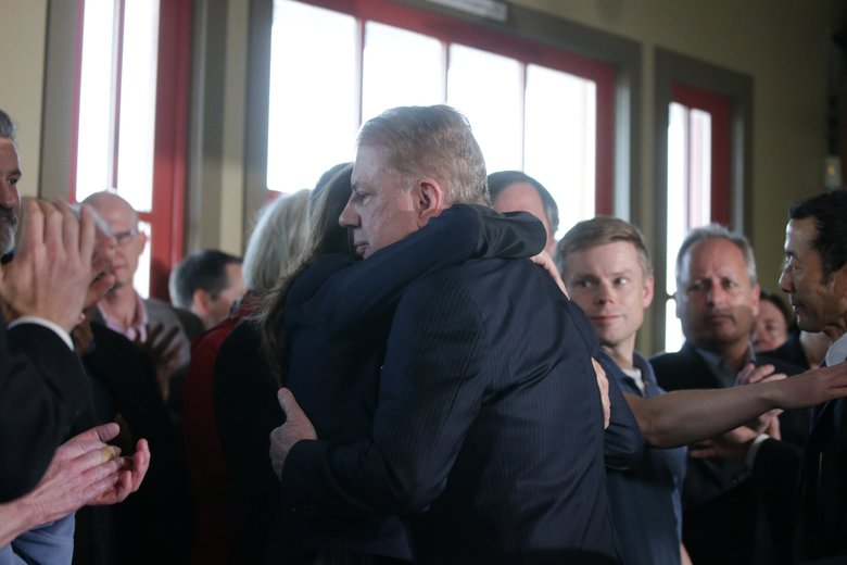 Seattle Mayor Ed Murray hugs supporters after his Tuesday announcement that he wouldn't seek re-election. (Bettina Hansen / The Seattle Times)