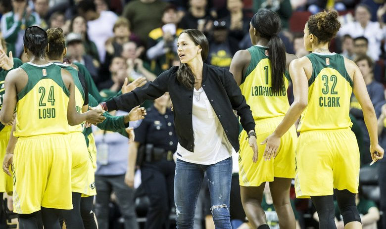 Seattle Storm guard Sue Bird, out of the game recovering from knee surgery, congratulates her teammates as they lead in the final minute and defeat the Indiana Fever 87-82 .  (Bettina Hansen / The Seattle Times)