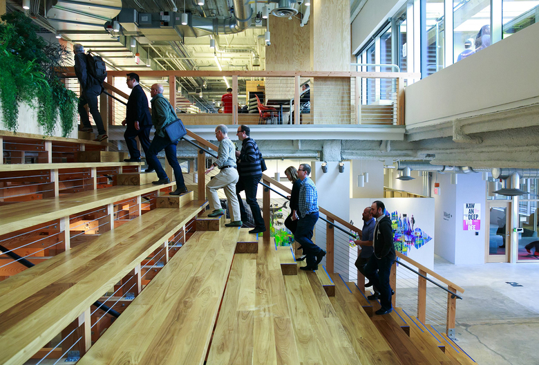 Facebook employees lead a tour through their new offices in Seattle's South Lake Union neighborhood last year. (Erika Schultz/The Seattle Times)
