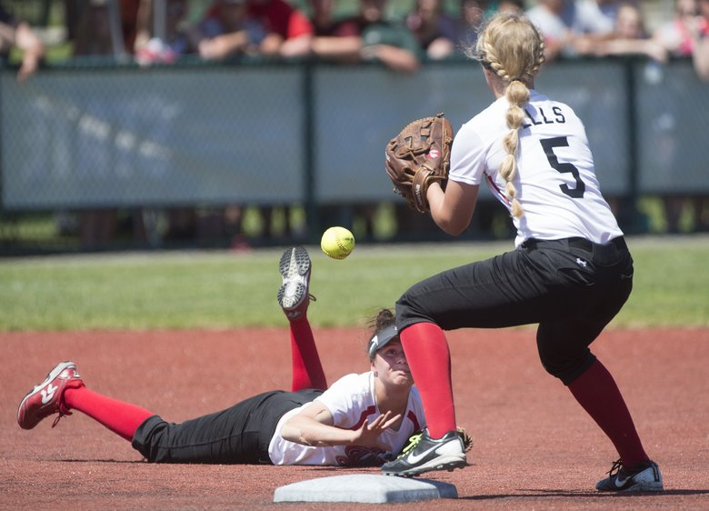 Yelm shortstop Mackinzee Moore tosses the ball to second baseman Jaeden Ells for a force out after making a diving stop of a Redmond grounder in the Class 3A softball state championship game at the Regional Athletic Complex in Lacey on Saturday. (Tony Overman/toverman@theolympian.com)
