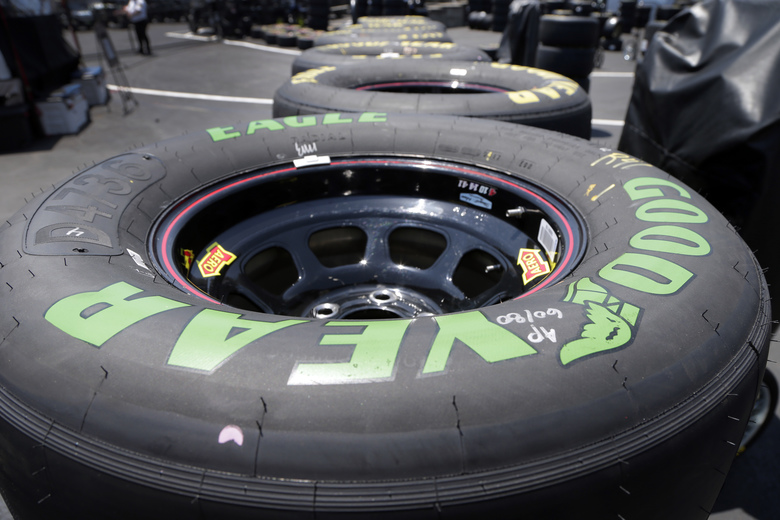 A green-lettered soft tire is shown with the standard tires during practice for Saturday's NASCAR Cup series All-Star auto race at Charlotte Motor Speedway in Concord, N.C., Friday, May 19, 2017. NASCAR is allowing teams to use a tire with a softer tread that will generate speeds up to a half-a-second per lap faster during the All-Star race. (AP Photo/Chuck Burton)