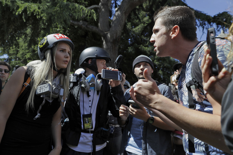 Demonstrators sharing opposing views argue during a rally April 27 in Berkeley, Calif. Demonstrators gathered near the University of California, Berkeley, campus amid a strong police presence and rallied to show support for free speech and condemn the views of Ann Coulter and her supporters.  (Marcio Jose Sanchez/AP)