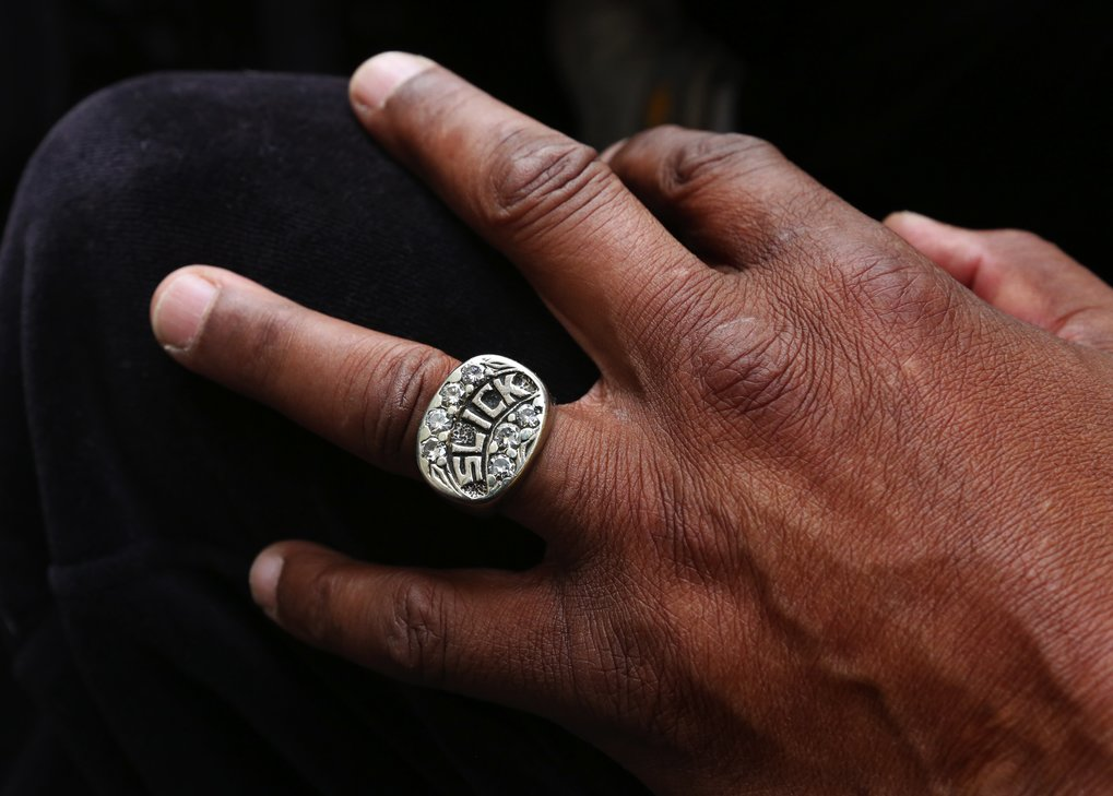 SuperSonics legend Slick Watts has an appropriate ring, a gift from the team owner Sam Schulman who founded the team.  (Alan Berner/The Seattle Times)