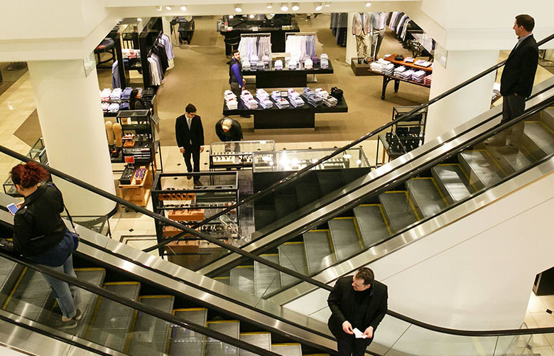 Customers travel on escalators at Nordstrom's downtown Seattle flagship store. (Erika Schultz/The Seattle Times)