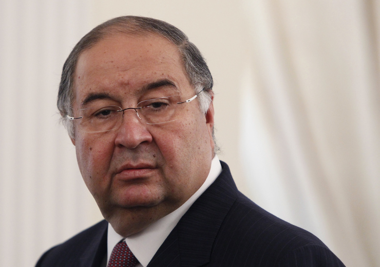 FILE – In this Thursday, Sept. 12, 2013 file photo, Uzbek-born Russian businessman Alisher Usmanov attends a meeting of Russian President Vladimir Putin and Crown Prince Sheik Mohammed bin Zayed Al Nahyan of the United Arab Emirates at the Novo-Ogaryovo state residence outside Moscow. A person familiar with the situation says Arsenal shareholder Alisher Usmanov has had an offer to buy out owner Stan Kroenke rejected. The person told The Associated Press that Usmanov's offer valued the Premier League club at $2 billion. The person spoke on condition of anonymity to discuss the club's financial matters. (Maxim Shemetov/Pool Photo via AP, File)