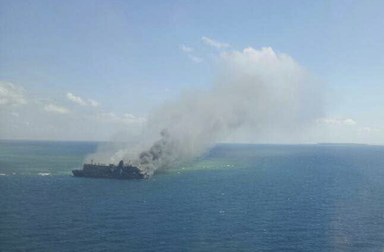 In this aerial photo released by Indonesian Search And Rescue Agency (BASARNAS), thick smoke billows from passenger ferry Mutiara Sentosa 1 which caught fire in Java Sea Saturday, May 20, 2017. The ferry caught fire Friday evening leaving a number of people dead and hundreds others rescued, Indonesian authorities said Saturday. (BASARNAS via AP)
