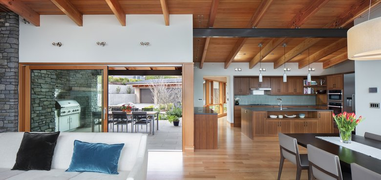 "The living area, dining area and kitchen form ""the core"" of the house, architect James Steel says, with two huge lift-and-slide doors leading to the front deck. (Steve Ringman/The Seattle Times)"