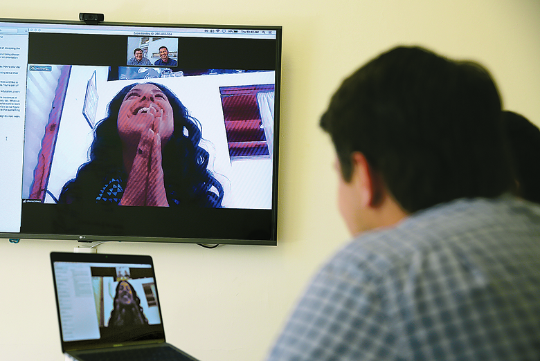 In April, a student learns of her acceptance to MissionU during an interview with co-founders Mike Adams, left, and Adam Braun, right, in San Francisco. (AP Photo/Eric Risberg)
