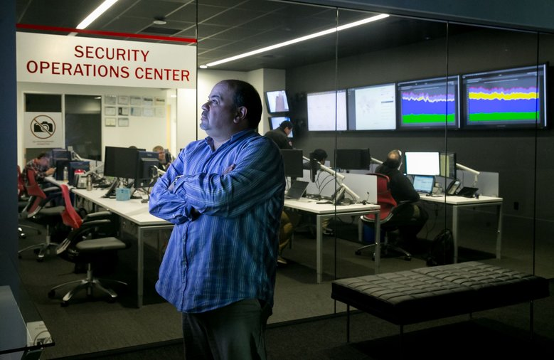 Ray Pompon, a cybersecurity researcher with F5 Networks, works at the company's security-operations center in Seattle on Tuesday. Security researchers worked over the weekend to better understand the malicious software and encourage technologists to update old systems.  (Erika Schultz/The Seattle Times)
