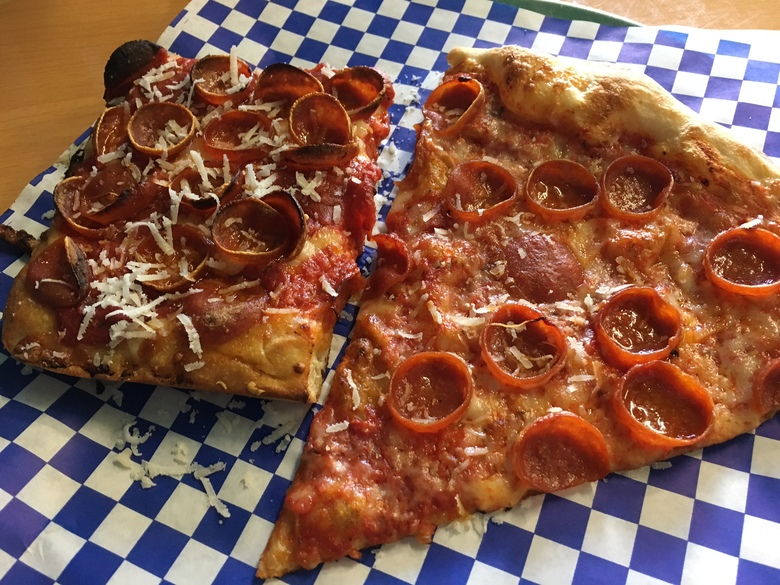 While the New York-style pepperoni slice on the right is good, the Sicilian version has an extra zing spice-lovers will crave. (Paige Collins / The Seattle Times)