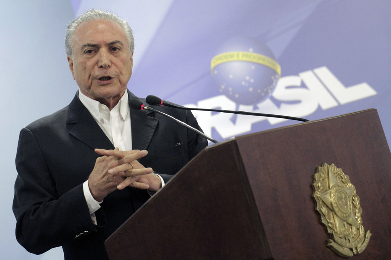Brazil's President Michel Temer speaks during a national address from the Planalto Presidential Palace, in Brasilia, Brazil, Saturday, May 20, 2017. Temer is suggesting that an audio that purportedly recorded him supporting hush money for an ex-lawmaker has been doctored. Temer says his administration will petition the Supreme Federal Tribunal to suspend the investigation against him until the audio is verified. (AP Photo/Eraldo Peres)