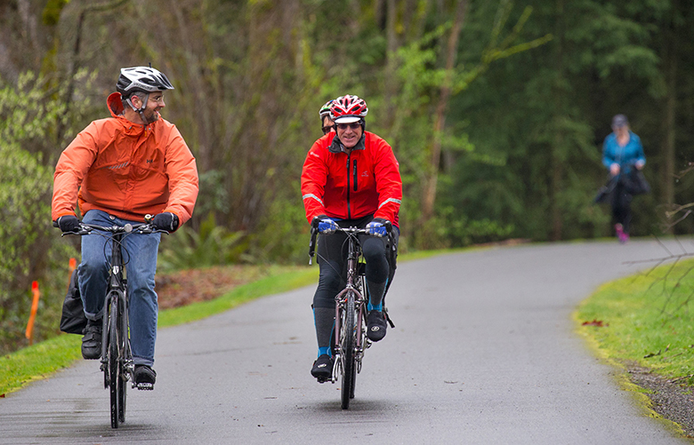 "Day Murti, left, is joined by Wayne and Patty (behind Wayne in a tandem bike) Methner on one of many Cascade Bicycle Club's free rides. This ride started off at Log Boom Park/Tracy Owen Station in Kenmore on Friday March 24th, 2017 and traveled to Bothell along the Burke-Gilman Trail. This is part of the ""Getting Ready to Ride"" series."