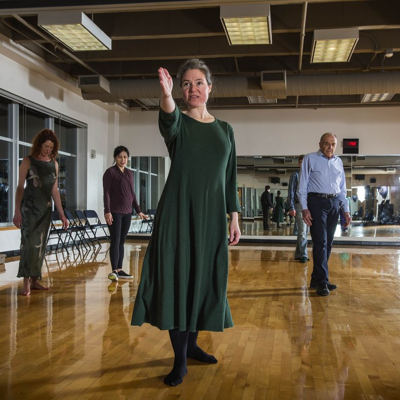 Chloe Lewis, co-founder of Broadway Waltz, instructs a class. She teaches polka and waltz. (Dean Rutz/The Seattle Times)