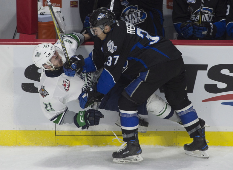 Saint John left wing Cole Reginato, right, collides with Thunderbirds center Matthew Wedman. (Adrian Wyld/AP)