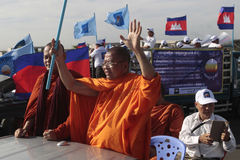 Cambodian Buddhist monks join the opposition Cambodia National Rescue Party (CNRP) rally during the first day of the country's commune election campaign at outside Phnom Penh, Cambodia, Saturday, May 20, 2017. Ten of thousands of Cambodians kicked off a two-week campaign period Saturday for local elections that are seen as important indicators of how the big political parties are doing nationally. (AP Photo/Heng Sinith)