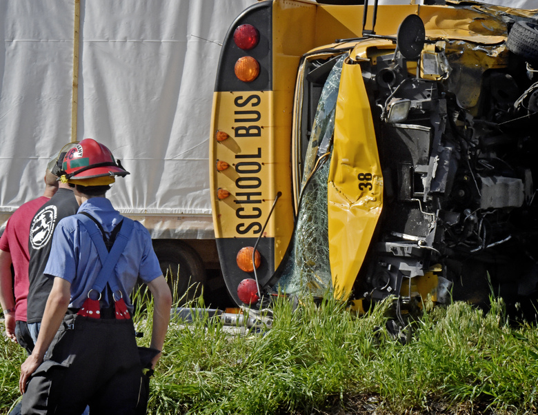 School bus flips in hit-and-run crash; 16 taken to hospital