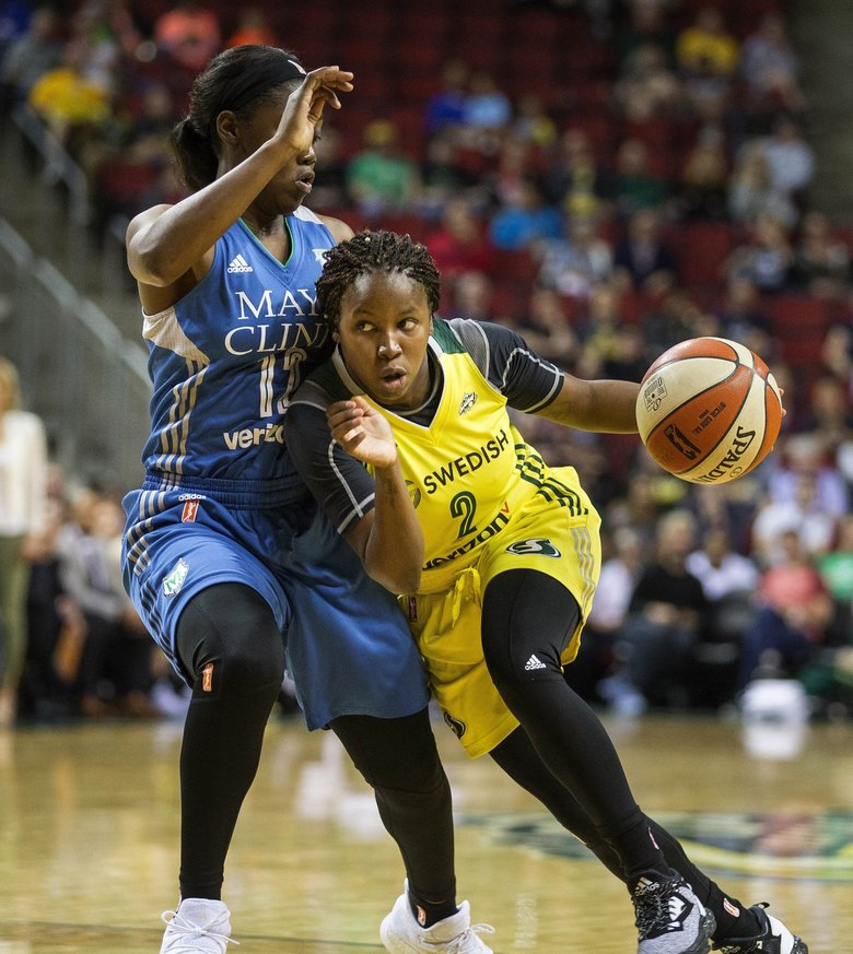 Seattle's Alexis Peterson tries to press into the lane, but defensive pressure is applied by Minnesota's Alexis Jones in the 4th quarter.  The Minnesota Lynx played the Seattle Storm in WNBA action Saturday, June 3, 2017 at KeyArena in Seattle.(Dea n Rutz / The Seattle Times)