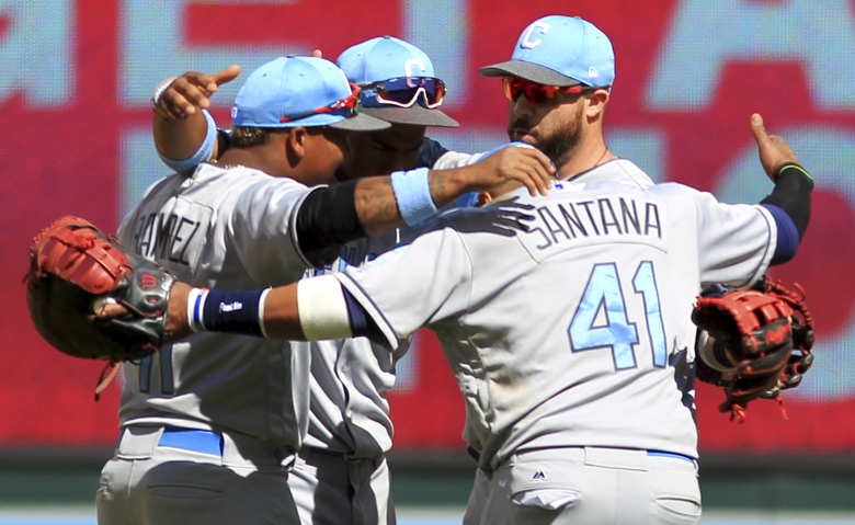 Cleveland Indians Carlos Santana (41), Jose Ramirez (11), Bradley Zimmer (4) and Lonnie Chisenhall celebrate after defeating the Minnesota Twins, 5-2, during a baseball game on Sunday, June 18, 2017 in Minneapolis. (AP Photo/Andy Clayton-King)