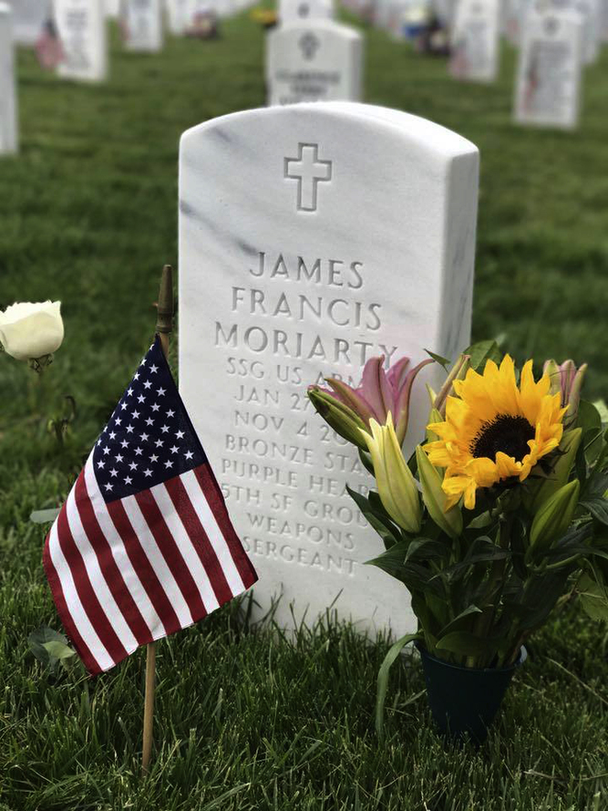 This 2017 photo shows the tombstone in Arlington National Cemetery in Virginia of 27-year-old Staff Sgt. James F. Moriarty of Houston, Texas, who died along with two other Green Berets in a Jordanian air base on Nov. 4, 2016 in circumstances that remain unclear. (AP photo courtesy of James Moriarty)