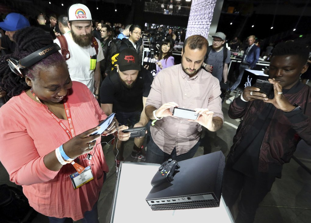 Fans try out the Xbox One X at E3 in Los Angeles. The reception to the device was mixed.  (Casey Rodgers/Invision for Microsoft)