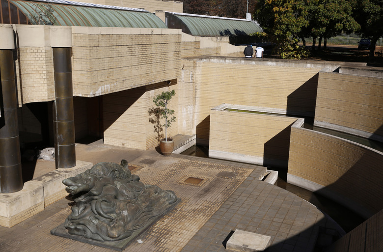 This photo taken Friday, May 19, 2017, shows the closed main entrance to the Johannesburg Art Gallery, in Joubert Park, Johannesburg. The gallery has been struggling with water damage, low morale and a lack of funding, with deeper challenges including identifying audiences in a country with pressing social problems and a history of racial conflict. (AP Photo/Denis Farrell)