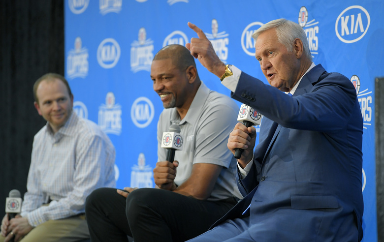 Jerry West, right, speaks during a news conference to introduce him as an advisor to the Los Angeles Clippers as Clippers executive vice president of basketball operations Lawrence Frank, left, and president of basketball operations and head coach Doc Rivers listen, Monday, June 19, 2017, in Los Angeles. (AP Photo/Mark J. Terrill)
