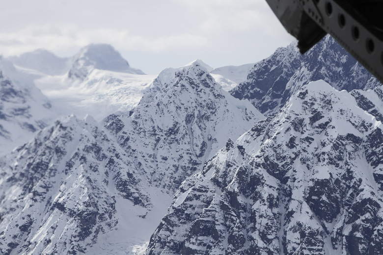FILE – This April 24, 2016, file photo taken above the Kahiltna Glacier near Denali, shows peaks in the Alaska Range, as seen through the open cargo bay doors of a Chinook helicopter. Rangers rescued two climbers in unrelated incidents from Kahiltna Glacier in Denali National Park on Monday, June 5, 2017. (AP Photo/Mark Thiessen, File)