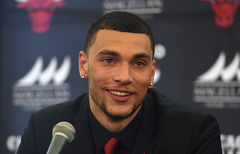 Zach Lavine listen to questions during a news conference at the Chicago Bulls NBA basketball team training facility, Tuesday, June 27, 2017, in Chicago. Levine was acquired by the Bulls from the Minnesota Timberwolves. (AP Photo/G-Jun Yam)