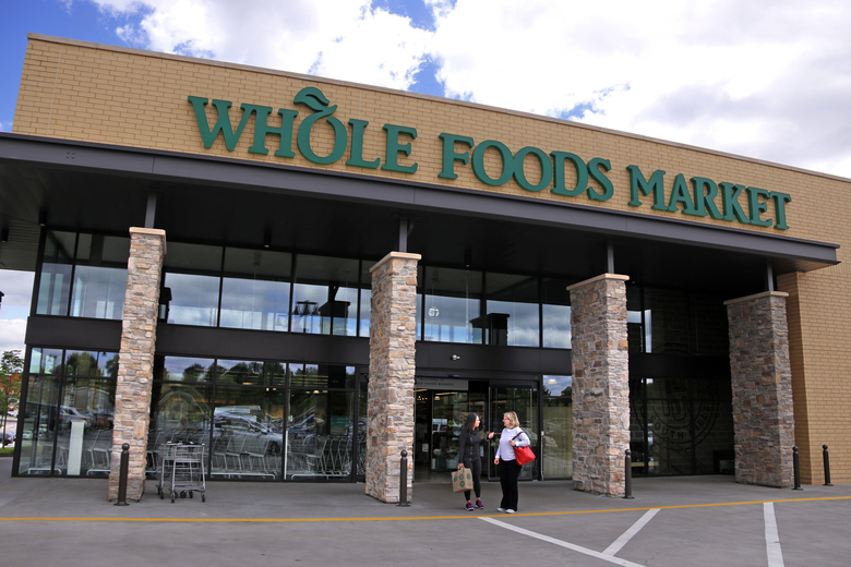 Amazon shares hit intraday high in wake of Whole Foods deal