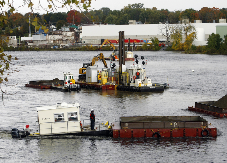 FILE – In this Oct. 7, 2009 file photo, crews dredge a section of the Hudson River in Fort Edward, N.Y. Dredging began in the spring of 2009 after decades of argument over how to deal with tons of PCBs that flowed down the river after a dam in the area was removed. General Electric plants in Fort Edward and neighboring Hudson Falls discharged wastewater containing PCBs. A highly anticipated assessment of General Electric's six-year cleanup of the Hudson River is scheduled to be released by the federal Environmental Protection Agency on Thursday, June 1, 2017. Elected officials who want more pockets of the upper river dredged hope the analysis strengthens their argument. (AP Photo/Mike Groll, File)