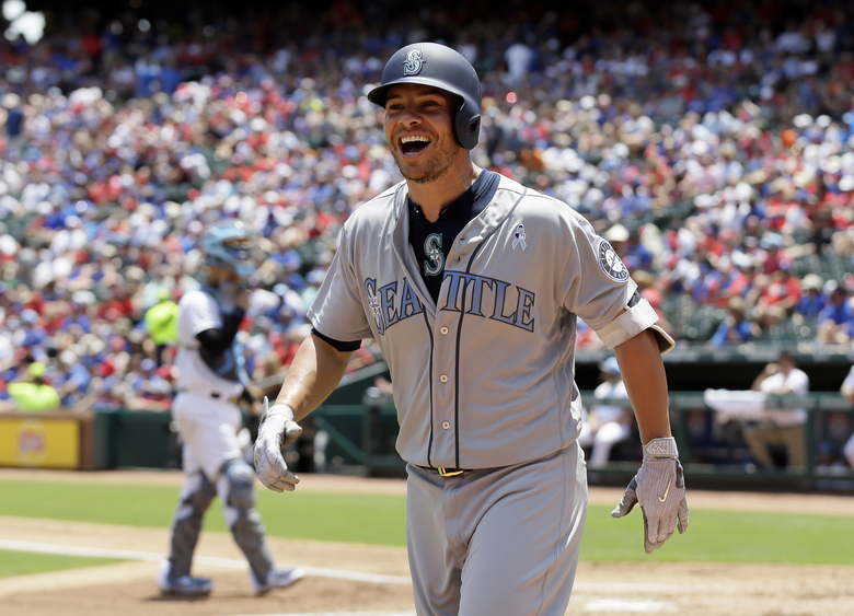 Seattle Mariners' Danny Valencia smiles as he jogs to the dugout after hitting a two-run home run off a pitch from Texas Rangers' Yu Darvish in the first inning of a baseball game, Sunday, June 18, 2017, in Arlington, Texas. (AP Photo/Tony Gutierrez) (Tony Gutierrez/AP)