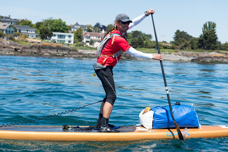Karl Kruger on his stand-up paddleboard at the start of the Race to Alaska. (Katrina Zoe Norbom photo)