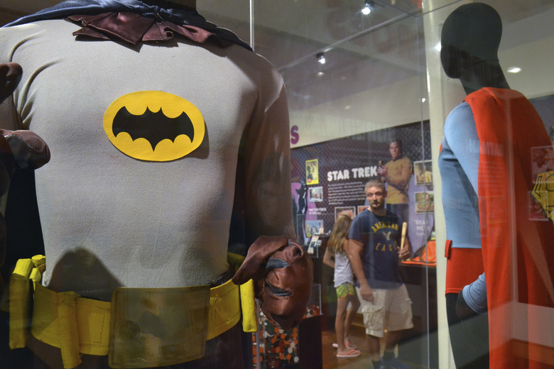 "In this May 29, 2015 file photo, a Batman costume worn by Adam West in the 1960s television show is on display next a Superman costume worn by Christopher Reeve in ""Superman IV"" at the Louisville Slugger Museum in Louisville, Ky. On Saturday, June 10, 2017, West's family said the actor has died at age 88. (Dylan Lovan / The Associated Press)"