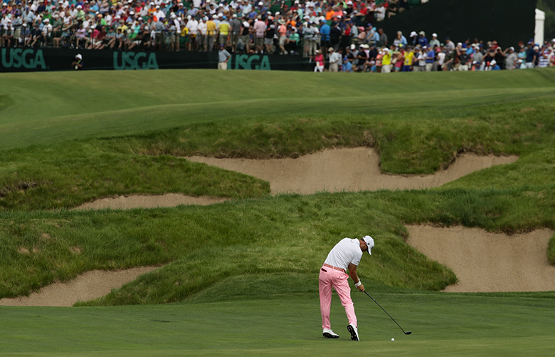 Justin Thomas hits to the 18th green during the third round of the U.S. Open golf tournament Saturday, June 17, 2017, at Erin Hills in Erin, Wis. (AP Photo/A Charlie Riedel)