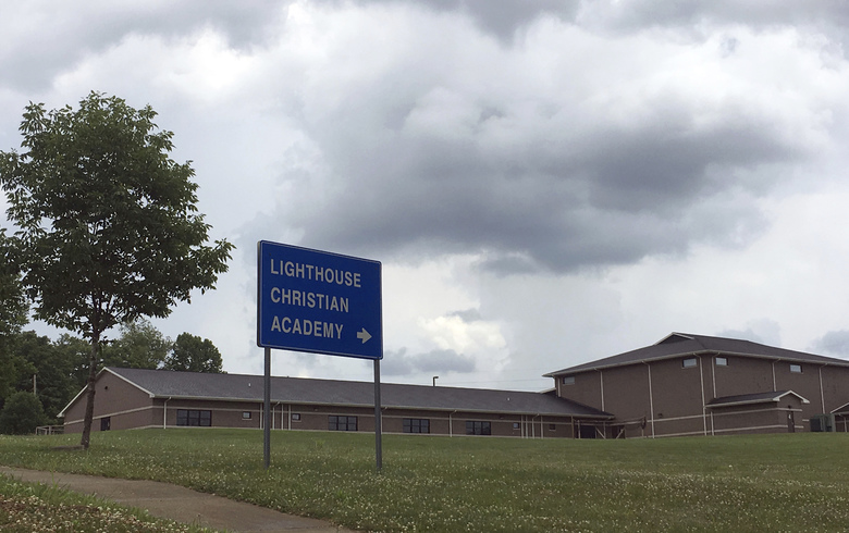 The Lighthouse Christian Academy is seen on Tuesday, June 13, 2017, in Bloomington, Ind. In its brochure the school promises an exemplary education, a caring atmosphere and a service to God _ but not for everyone. The school reserves the right to deny admission to LGBT students because it views their lifestyle as immoral. (AP Photo/Brian Slodysko)