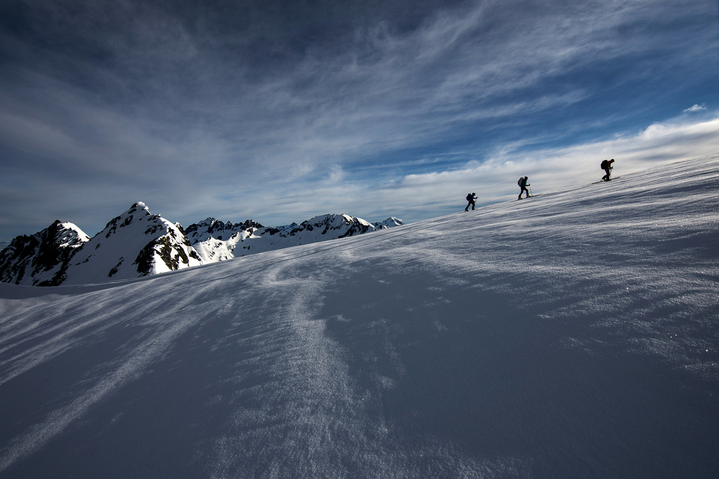 From left to right, Matt Henry, Forest McBrian and Trevor Kostanich travel on the Upper Le Conte Glacier. (Scott Rinckenberger / www.scottrinck.com)