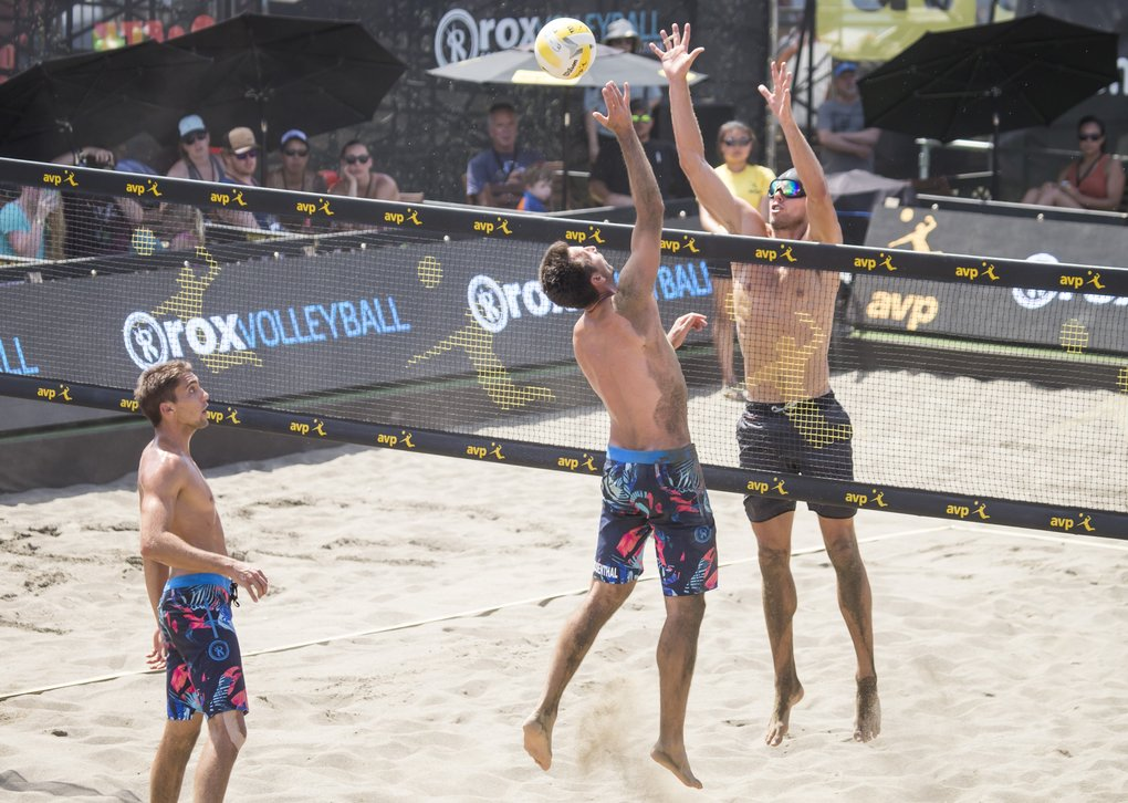 Stafford Slick, facing, blocks an attempt by Sean Rosenthal during the men's final of the AVP Seattle Open at Lake Sammamish State Park in Issaquah on Sunday.. (Bettina Hansen/The Seattle Times)