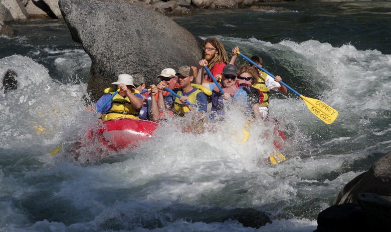 Henry Miller, top center, guides his raft through rapids on the Wenatchee River. (Alan Berner/The Seattle Times)