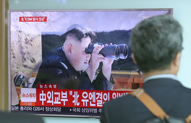 A man walks by a TV screen showing a local news program reporting about North Korea's missile firing with an image of North Korean leader Kim Jong Un, at Seoul Train Station in Seoul, South Korea, Tuesday, July 4, 2017. North Korea claimed to have tested its first intercontinental ballistic missile in a launch Tuesday, a potential game-changing development in its push to militarily challenge Washington — but a declaration that conflicts with earlier South Korean and U.S. assessments that it had an intermediate range. (AP Photo/Lee Jin-man)
