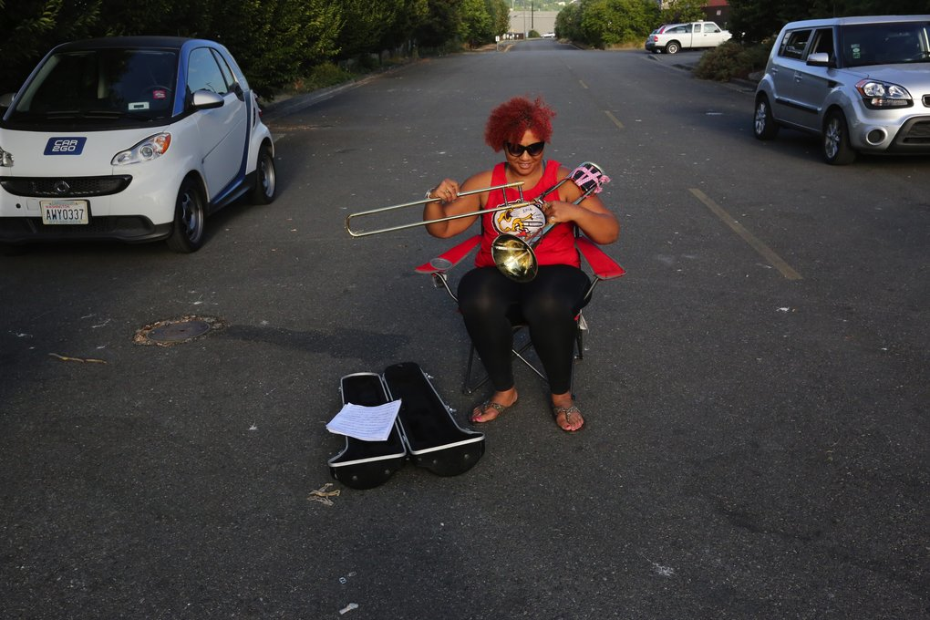 Tracy Rage, who'll be leading this practice, is among the first to arrive and readies her trombone. She also plays the French horn.  (Alan Berner/The Seattle Times)