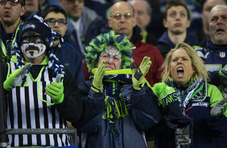 Seahawks fans celebrate as the team beats the Detroit Lions at CenturyLink Field on Jan. 7. Will there come a time where they will also be rooting for wagers they make on games? (Mike Siegel/The Seattle Times)