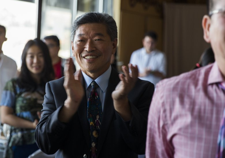State Sen. Bob Hasegawa, shown at a campaign event in South Lake Union, is barred from raising money for his mayoral run as long as the Legislature remains in session. (Kjell Redal / The Seattle Times)