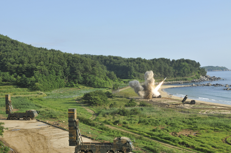 "In this photo provided by Eighth U.S. Army, a U.S. MGM-140 Army Tactical Missile, right, is fired into the east sea as South Korea's Hyunmoo Missile II, left, are seen during the combined military exercise against North Korea at an undisclosed location in South Korea, Wednesday, July 5, 2017. North Korea delighted in the international furor created by its first launch of an intercontinental ballistic missile, vowing Wednesday to never give up its missiles or nuclear weapons and to keep sending Washington more ""gift packages"" of weapons tests. U.S. and South Korean forces, in response, engineered what was meant as a show of force for Pyongyang, with soldiers from the allied nations firing ""deep strike"" precision missiles into South Korean territorial waters. The missile firings Tuesday demonstrated U.S.-South Korean solidarity, the U.S. Eighth Army said in a statement. (Eighth U.S. Army via AP)"