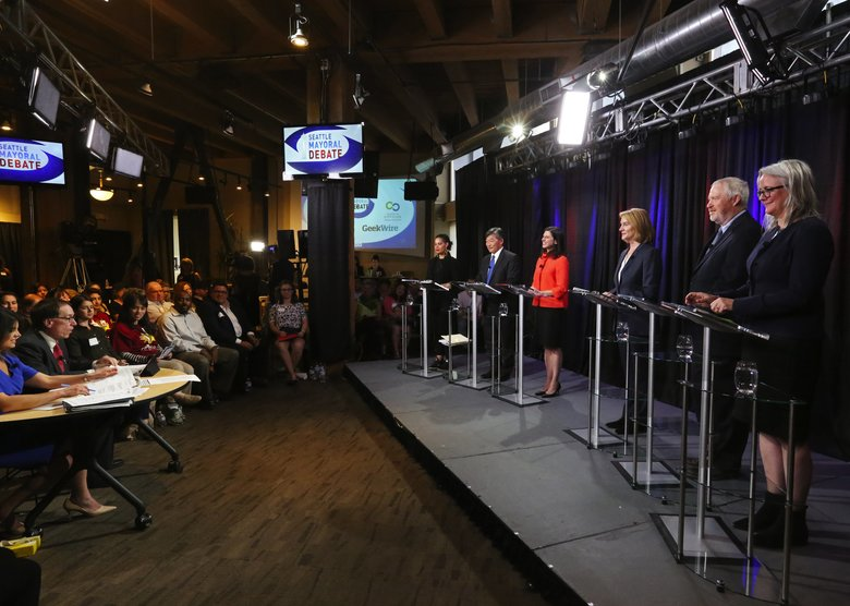Seattle mayoral candidates, from left, Nikkita Oliver, Bob Hasegawa, Jessyn Farrell, Jenny Durkan, Michael McGinn and Cary Moon, appear in a debate. (Ken Lambert/The Seattle Times)