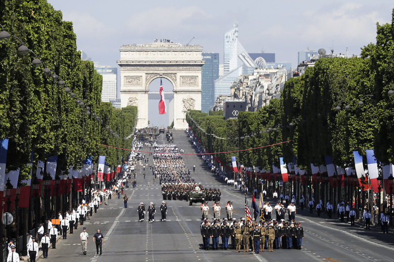 U.S troops march down the Champs Elysees avenue during the Bastille Day parade in Paris on July 14, with President Trump was the guest of honor. At Trump's request, U.S. officials say they have begun to plan a grand military parade showcasing the might of America's armed forces.( AP/Photo/Markus Schreiber, file)