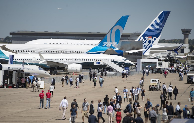 Visitors tour Boeing aircraft at this year's Paris Air Show. Boeing reports its second-quarter financial results on Wednesday. (IAN LANGSDON/EPA)