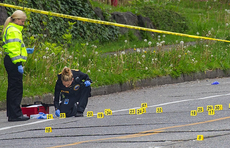 Seattle Police investigate empty bullet casings where a woman and a man were shot at Martin Luther King Jr. Way and South Charles Street early this morning May 4th, 2017. The man was taken to Harborview Medical Center and is in serious condition with life-threatening injuries, authorities said. The woman is being treated for minor injuries in the emergency room and will be released soon, Harborview spokeswoman Susan Gregg said Thursday morning. 201850