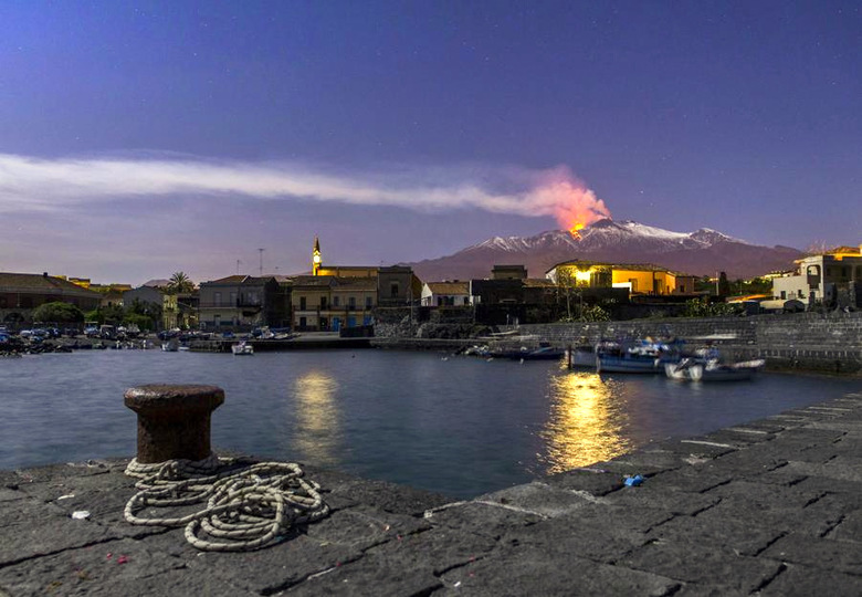 Mount Etna, Europe's most active volcano, spews lava during an eruption seen from the Sicilian village of Pozzillo, Italy.