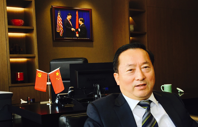 Credit: Hal BerntonPlace: Beijing, ChinaDate: May , 2017Cutline: Wu Lebin, a surgeon turned business, is chairman of CAS Holding that launched a joint venture to build a $1.8 billion dollar methanol plant in Kalama.Wu  is shown here in his Beijing office, where he has hung a  photo of his handshake with China's president, Xi Jinping, when  they both visited Seattle in 2015.The project has drawn support in Cowlitz County as a job creator, but also opposition led by environmental groups opposed to developing a new fossil fuel plant that relies on fracked natural gas.